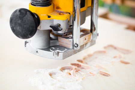 cnc machine: wood milling machine in action Stock Photo