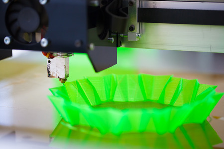 3d printer in action, printing abstract green shape