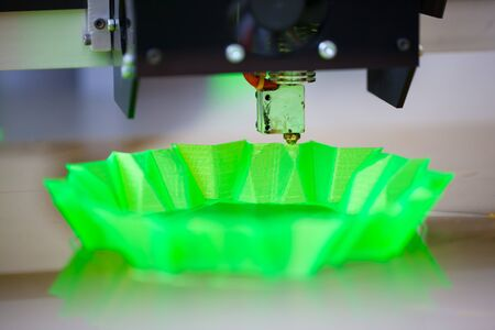 3d printer: 3d printer in action, printing abstract green shape