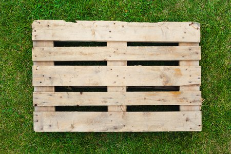 empty pallet on green grass