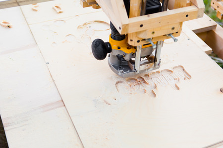 wood milling machine in action Banco de Imagens