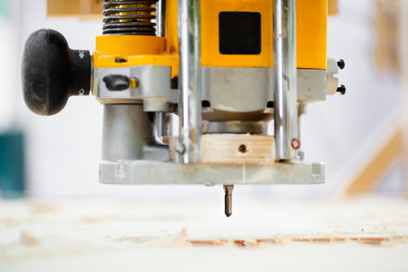 milling: wood milling machine in action Stock Photo