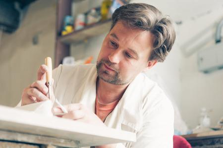maker: restorer making his work Stock Photo