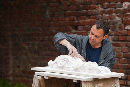 gypsum: craftsman restorer working with gypsum model Stock Photo