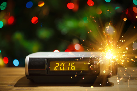 plastic christmas tree: Led display of digital clock with 2016 new year with sparkler