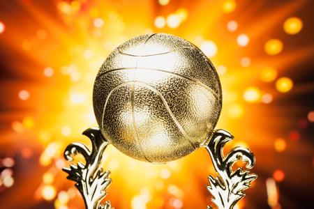 award background: basketball trophy against shiny sparks background