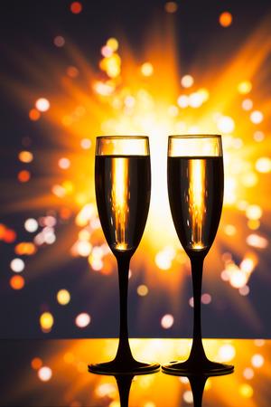 new love: champagne glass against sparkler background