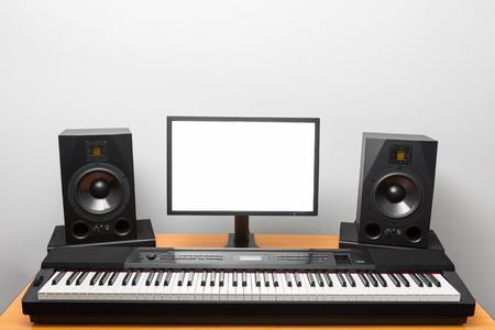 daw: digital audio workstation (daw) studio with electronic piano and monitor speakers Stock Photo