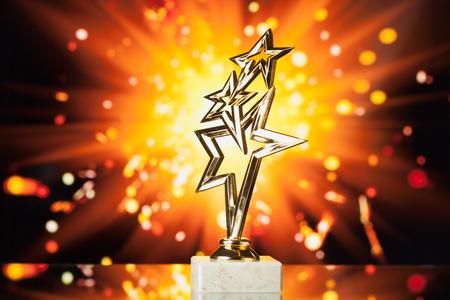 award background: gold stars trophy against shiny sparks background Stock Photo