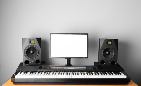 daw: digital audio workstation (daw) studio with electronic piano and monitor speakers Stock Photo