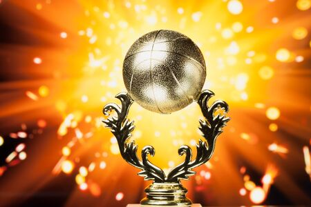 golden ball: basketball trophy against shiny sparks background