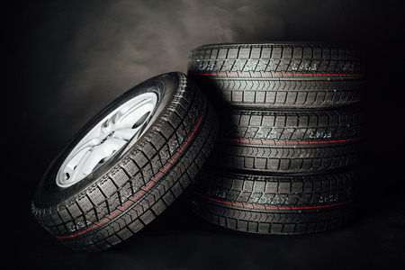 automobile tire: studless winter tires, black background Stock Photo