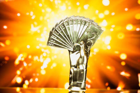 trophies: poker cards trophy against shiny sparks background Stock Photo
