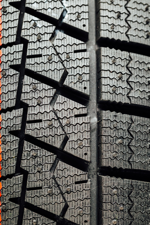 automobile tire: studless winter tire protector, closeup view Stock Photo