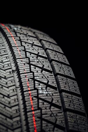 the protector: studless winter tire protector, closeup view Stock Photo