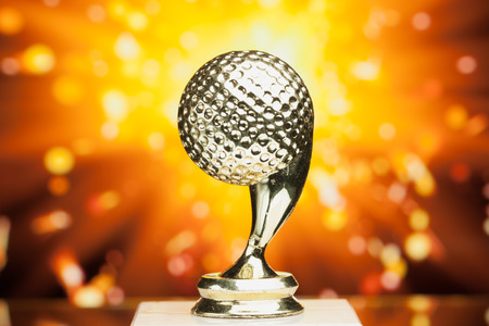 spark: golf ball trophy against shiny sparks background