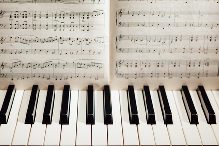 music book: piano keys and music book Stock Photo