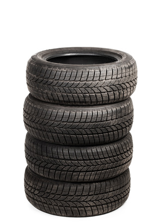 used: used winter tires isolated on white