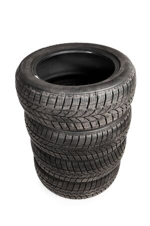 used winter tires isolated on white