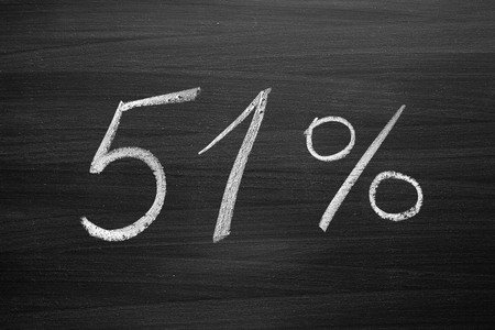 stockholder: 51-percent title written with a chalk on the blackboard