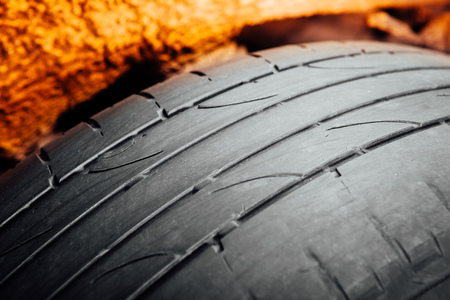 tire fitting: used car tire with worn-out depth of thread Stock Photo