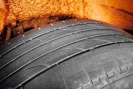 wornout: used car tire with worn-out depth of thread Stock Photo