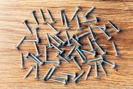 fasteners: screws fasteners hardware on wooden background