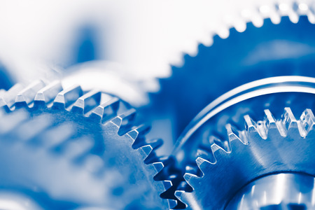 gear motion: industry background with blue gear wheels Stock Photo