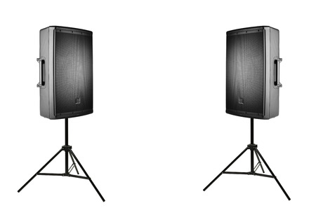 amplified: professional audio speakers PA on the tripods, isolated on white