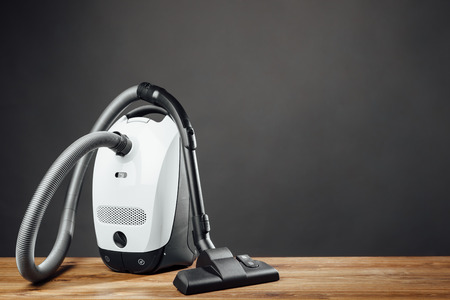 cleaner: vacuum cleaner on grey background
