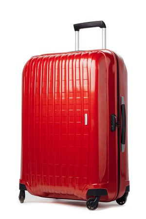 red carbon suitcase isolated on white Foto de archivo