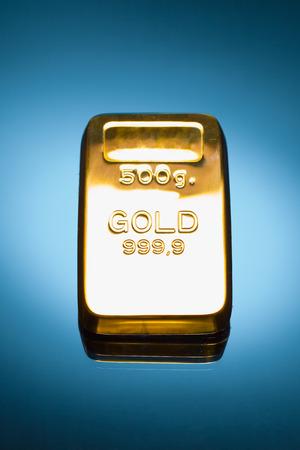 gold bar: gold bar against blue background