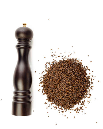 pepper mill and peppercorns heap, isolated on white Reklamní fotografie