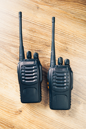 transmitter: portable radios Walkie-talkie on wooden background