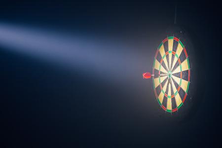 darts board illuminated with a spotlight