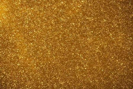 shiny gold: shiny particles gold background Stock Photo
