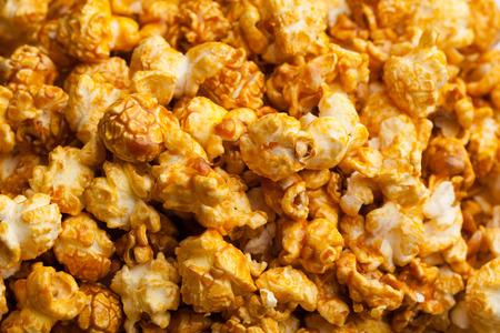fresh pop corn: caramel pop corn background, closeup view