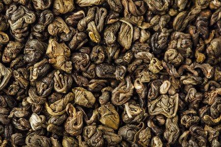 gunpowder tea: green tea leaves gunpowder background Stock Photo