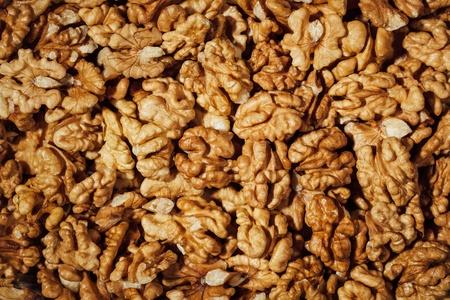 shelled walnuts background, closeup view