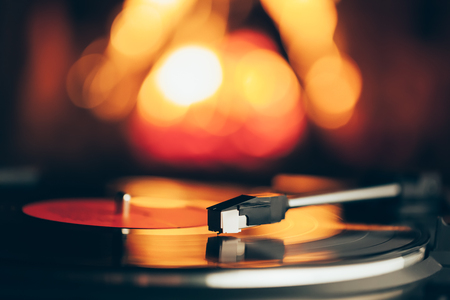 turntable with LP vinyl record against burning fire background Stock Photo