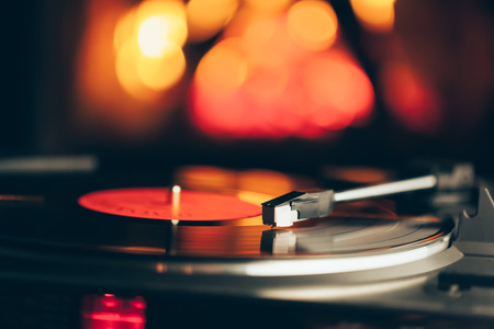 lp: turntable with LP vinyl record against burning fire background Stock Photo