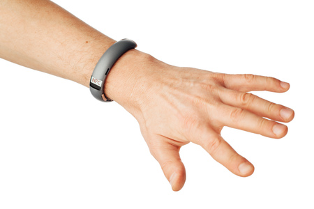 nfc: nfc wristband on hand, isolated on white