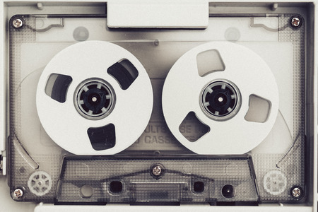vintage audio tape compact cassette, black and white with artistic film noise