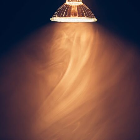 illuminations: halogen lamp with reflector, warm light in fog