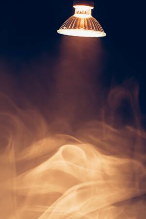 halogen lamp with reflector, warm spotlight in smoke