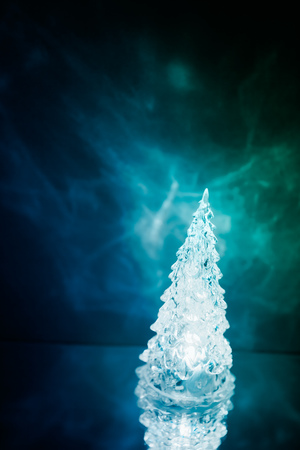 plastic christmas tree: Christmas tree lamp blue light with reflection Stock Photo