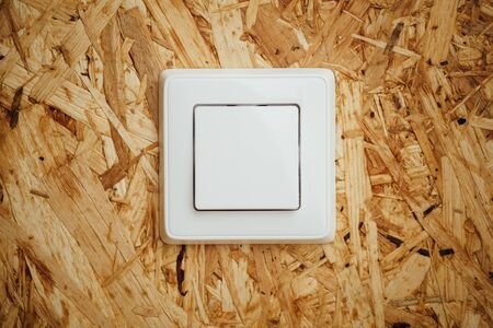 osb: electric light switch, wooden osb background