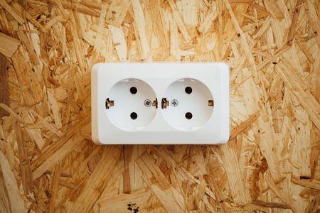 osb: AC power socket, wooden osb wall background