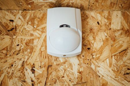 passive: motion detector (sensor) in action, osb wall background