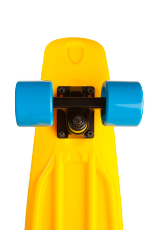yellow penny skateboard part, isolated on white Stock Photo